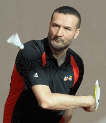 Nigel from Goslings LGBT badminton club hitting a shuttlecock