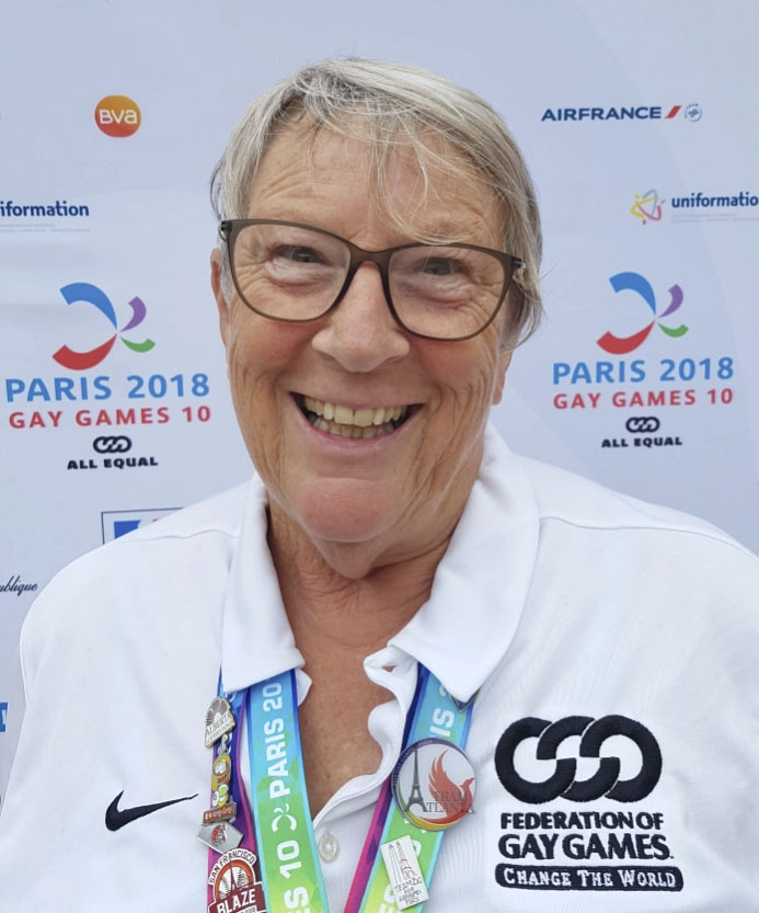 Viv from BLAGSS wearing Gay Games medals